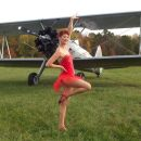 Kelly posing with the Stearman