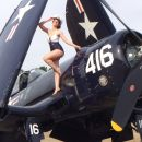 Kelly posing with the Corsair