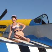 Lexi posing with the P-51 Mustang