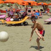 Beach Football between the  umbrellas