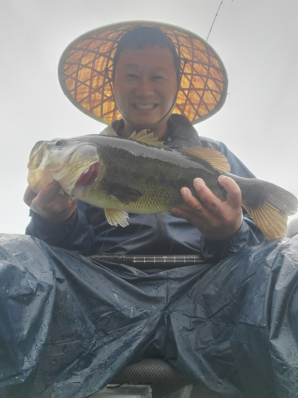 A photo of Asian Bucket  Man's catch