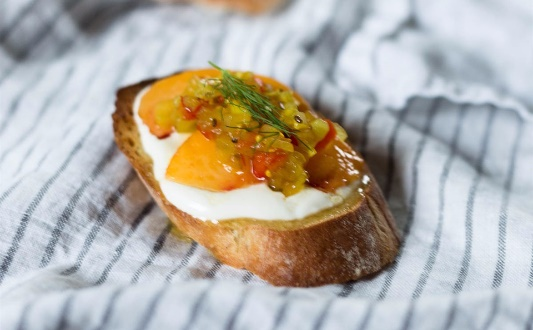 Homemade dill relish crostini with peaches and quark