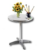 https://s3.amazonaws.com/photos.geni.com/p13/76/03/12/13/5344483e2f74f673/terras_table_flowers_brushes_in_cup_large.jpg