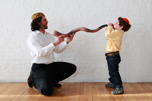 Father and son with shofar, copyright 2012, Jonathan Levine/JFNA. All other rights reserved.
