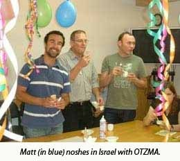 Matt (in blue) noshes in Israel with OTZMA