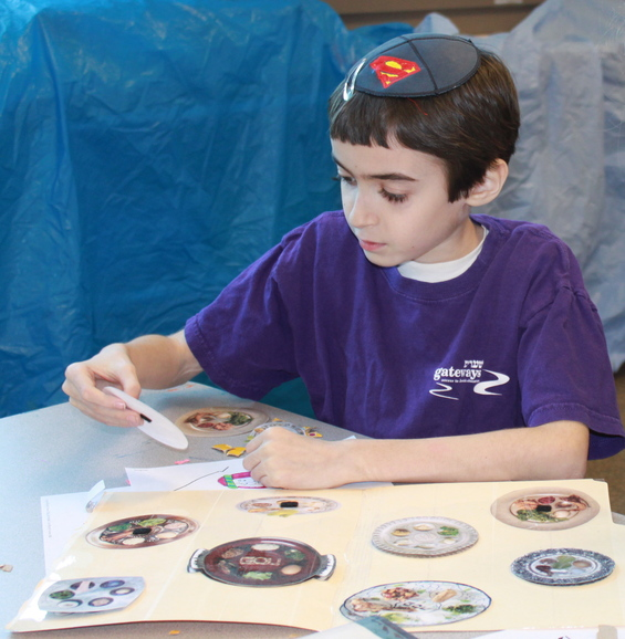 Jacob completes a seder plate file folder activity