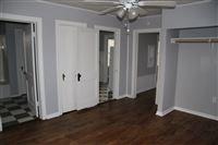 picture taken from bedroom. On left, bathroom. Next is closet, door to kitchen and way to living room.
