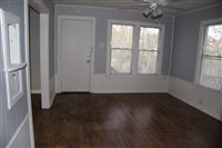 living area and entry door from bedroom