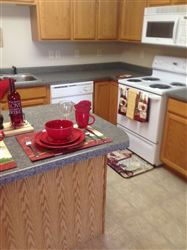 Island and great work triangle makes this a great kitchen for those who like to cook or hang out with the cook!
