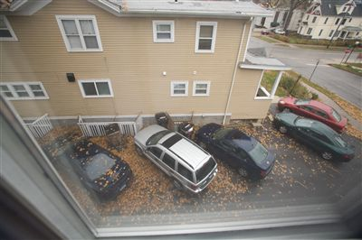 733 Oakland Ave., tenant parking in driveway.