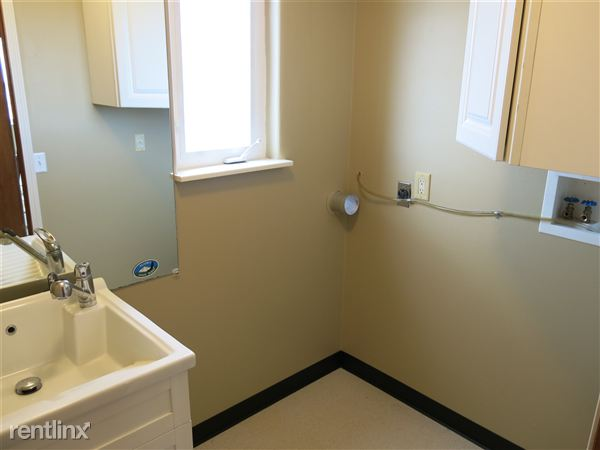 Lower level half bath and laundry hook up