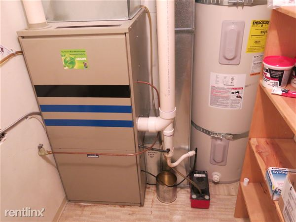 Energy efficient oil fired heating system and energy efficient electric water heater