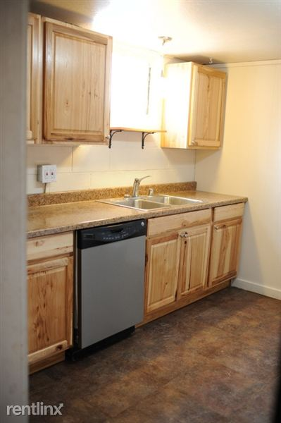 kitchen with new cabinets, flooring, countertop