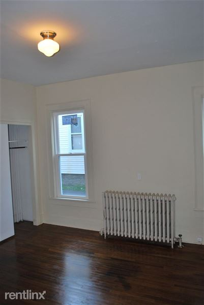 One of two large bedrooms with 10 foot ceilings  and steam heat