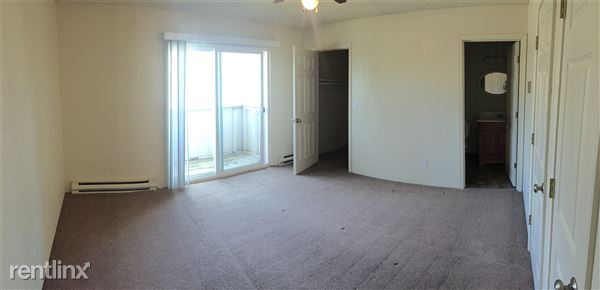 Bedroom with patio and walk in closet