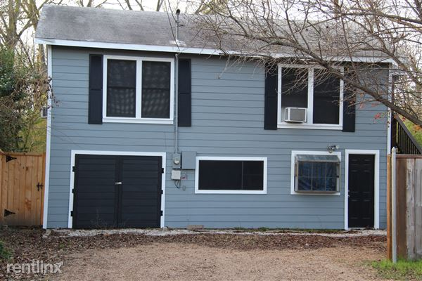 View of garage apartment at the end of the property off driveway