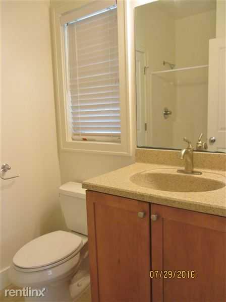 Bathroom shared between Bedrooms 2-3