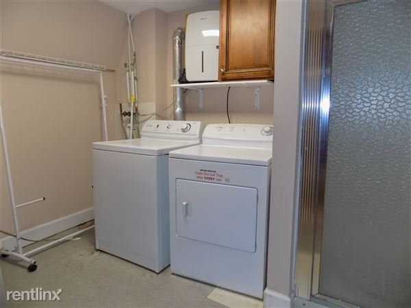 Laundry Room view 1 of 2- Basement. Has shower, fridge, and pantry.