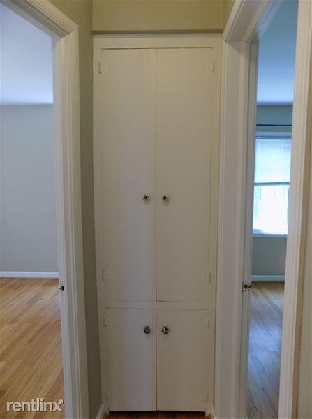 Hall between bedrooms and bathroom