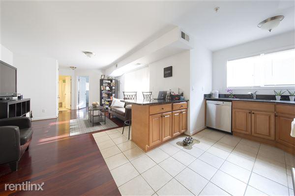 Cherry wood floors and open floor plan