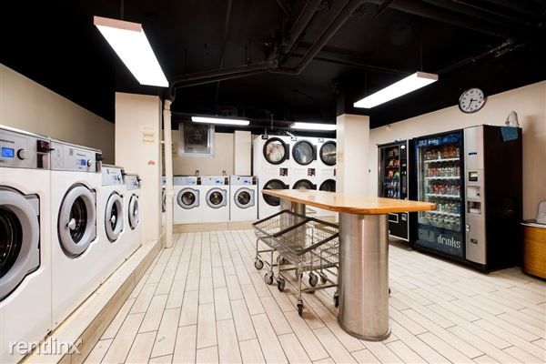 Newly upgraded laundry room in lobby, with card-operated smart machines that offer web/text alerts.
