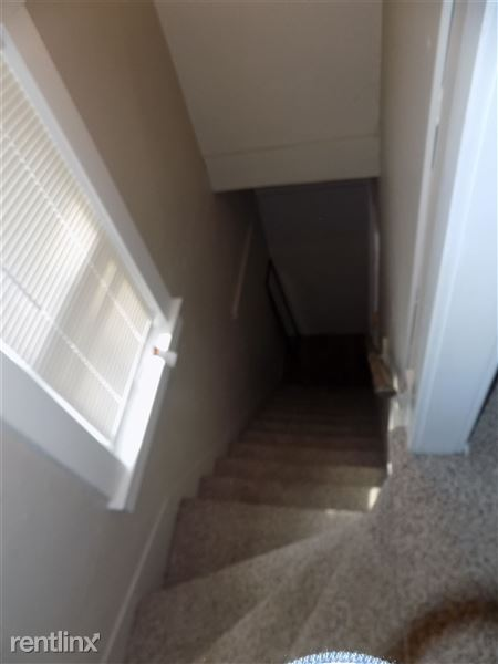 Rear Stairs to Bed 4 off of kitchen