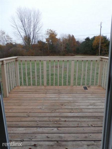 Deck Overlooking Backyard