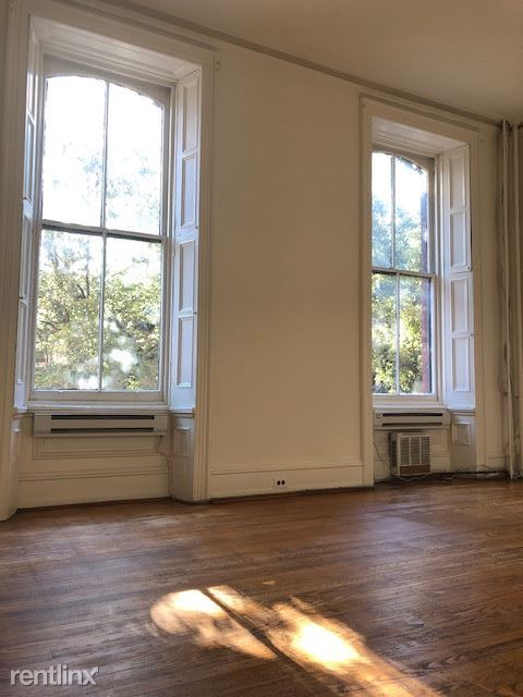 Stunning windows with original shutters. Interested in leasing? Visit www.wtprops.com to book your tour today!  In person and virtual tours available.