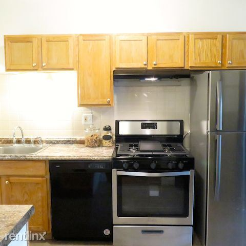 2209 E 70th St - 6 - Kitchen includes standard appliances and dishwasher