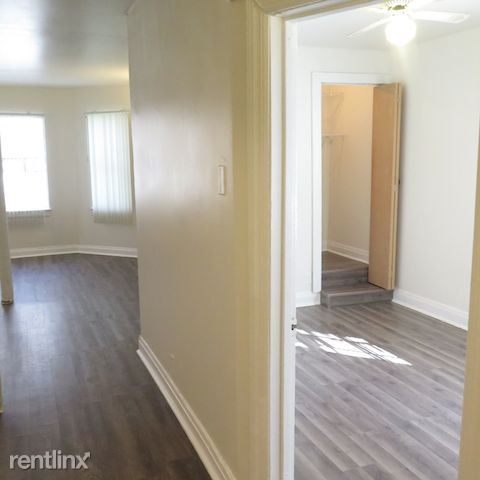 2209 E 70th St - 6 - Natural Light Pouring Into Bedroom and Living Room Area