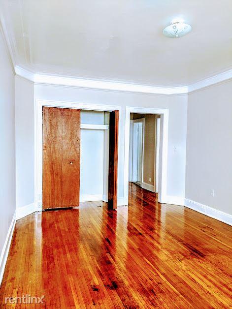 Hadley Hall - 3 - Living Room Closet Photo is representative
