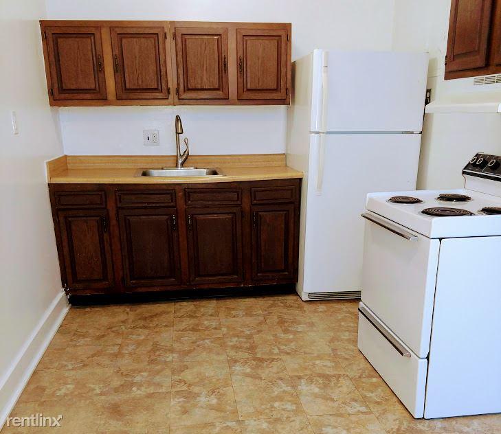 Hadley Hall - 4 - Sink, Refr & Stove Photo is representative