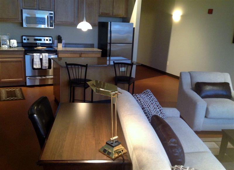 Desk and granite island kitchen