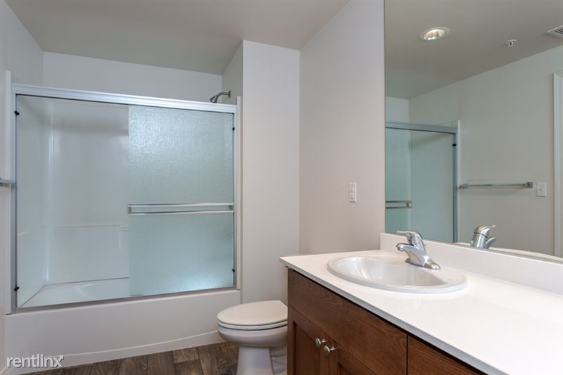 Large mirror in bathroom.