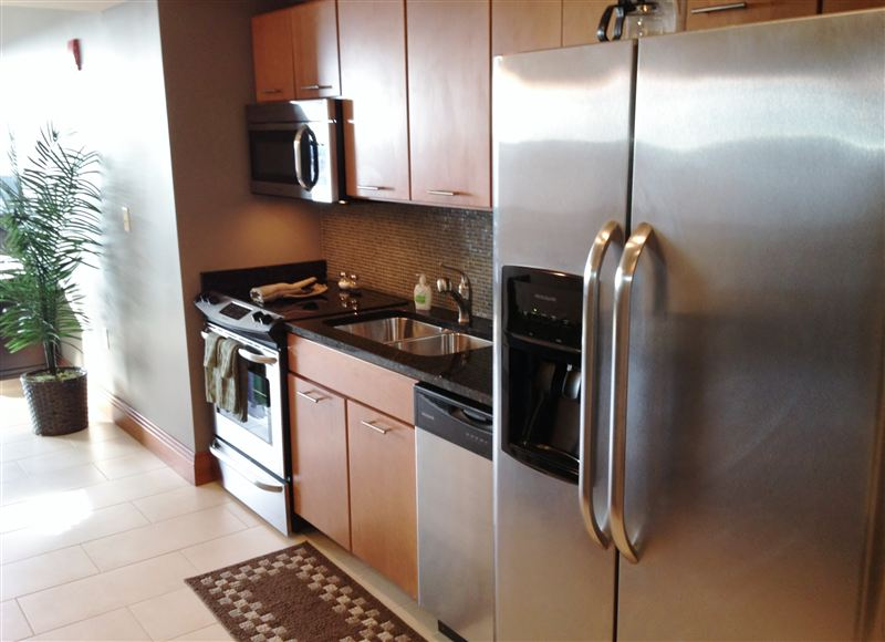 Granite counters and clean steel appliances