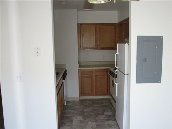 kitchen, complete with dishwasher, electric range and refrigerator