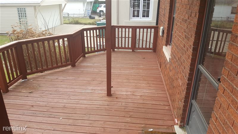Large private wood deck overlooking back yard