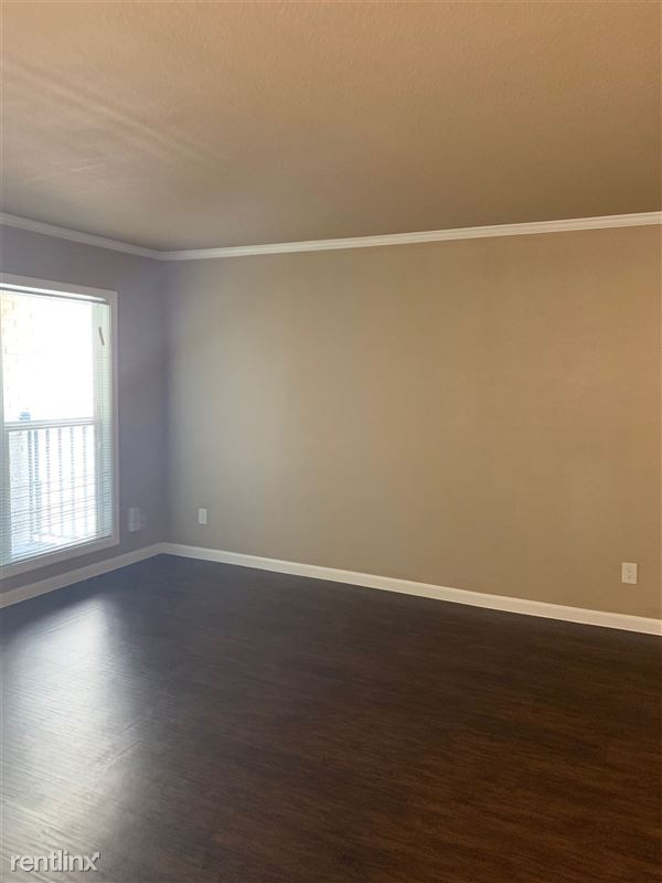 Spacious living room area w/lots of natural light... energy efficient widnows