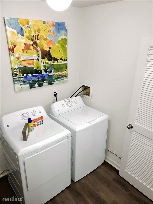 Westbury Village Townhouses - 16 - Laundry room with full size washer and dryers in every townhome