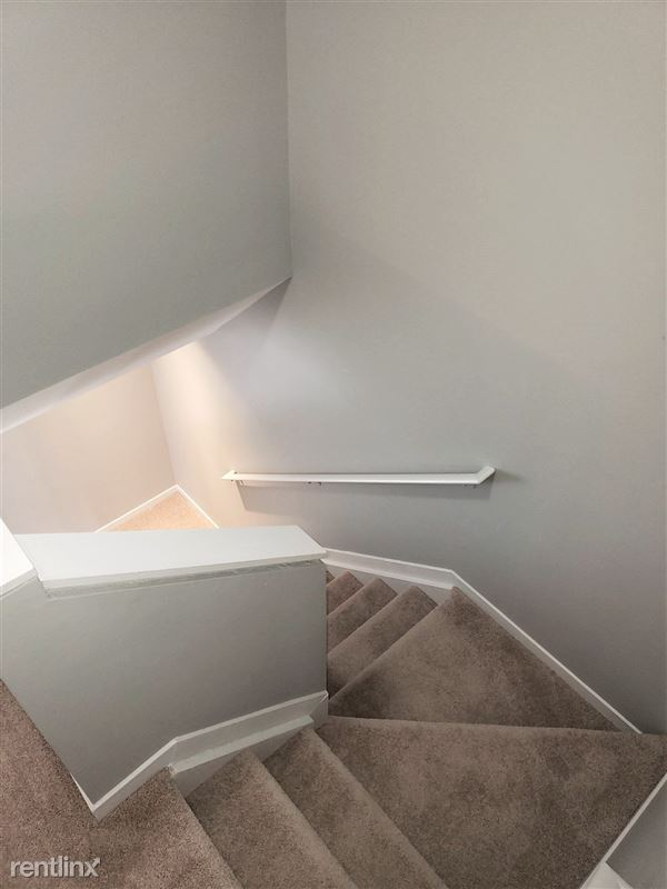 Westbury Village Townhouses - 15 - Unique Staircase that leads to bedrooms
