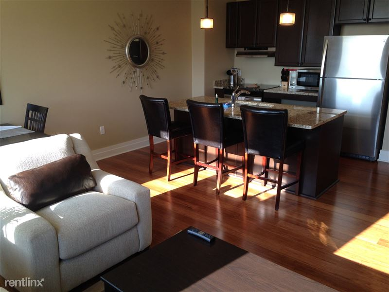 Detroit Flex-Lease/Furnished @ The David Whitney - 8 - LR to kitchen