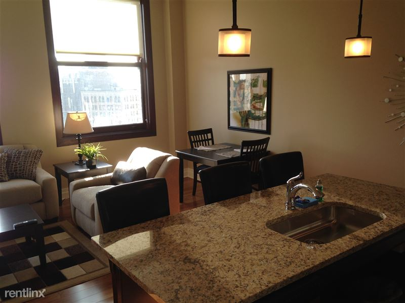 Detroit Flex-Lease/Furnished @ The David Whitney - 10 - Island and dining