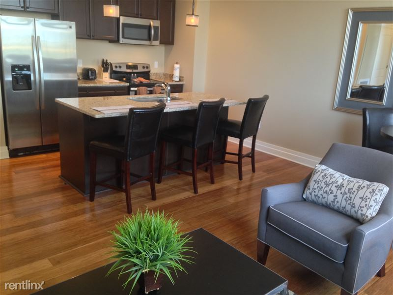 Detroit Flex-Lease/Furnished @ The David Whitney - 2 - 9-Kitchen - Island Bar and side Chair