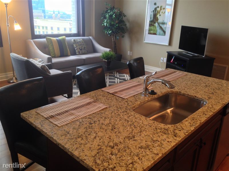 Detroit Flex-Lease/Furnished @ The David Whitney - 6 - 5-Kitchen Counter and Livingroom