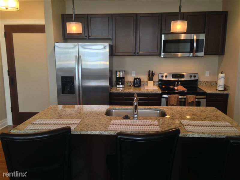 Detroit Flex-Lease/Furnished @ The David Whitney - 12 - 12-Kitchen and original entry door