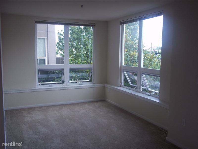Living room with corner windows