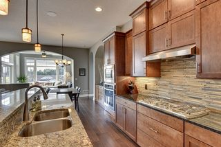 Granite countertops and custom tile backsplash