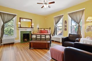 Bedroom 3 - The yellow room is bright & cheery, has its own fireplace with original tile - 2nd Floor