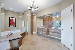 Main floor master bedroom bathroom - in floor heat, double vanity, separate tub and shower and stunning views.