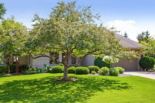 Mature trees & professionally landscaping make the front entry stand out!